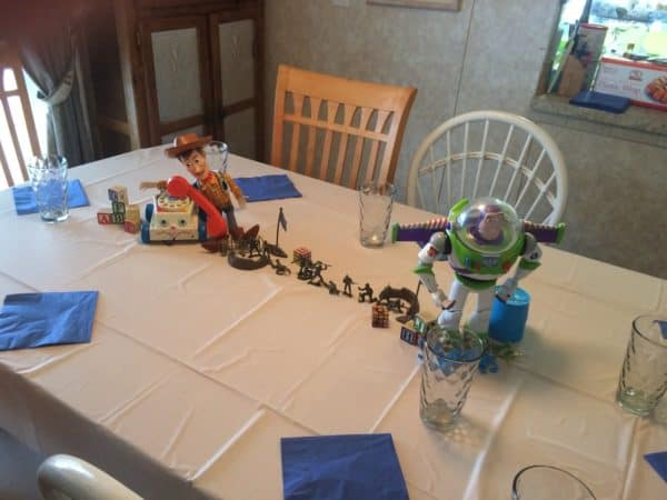 Toy Story Birthday Party complete with Woody, Buzz, Jessie, Potato Heads, barrel of monkeys and army men, Andy's bed and Pizza.