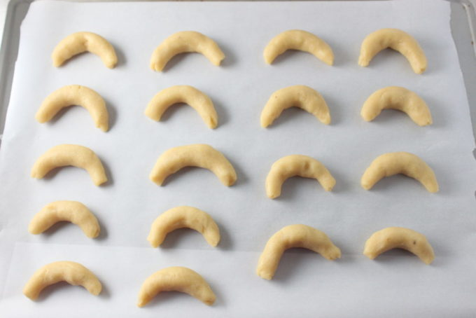 Vanillekipferl (German Vanilla Almond Crescent Cookies) recipe. A German Christmas cookie prepared with almond flour and vanilla beans.