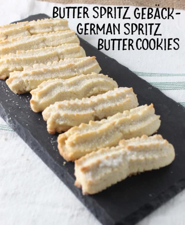 Butter Spritz Gebäck (German Spritz Butter Cookies) are Buttery, flaky, sugary, vanilla-scented cookies! Pipe them out or roll them out