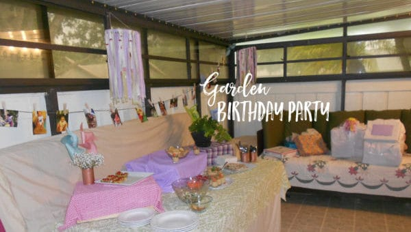 A Garden Birthday Party complete with butterfly garlands, spray-painted tin cans, pinwheels, wishing trees and embroidery hoop mobiles
