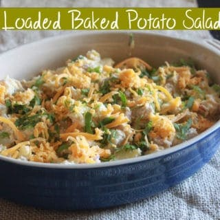 Bacon, cheese, and greek yogurt potato salad topped with green onions.