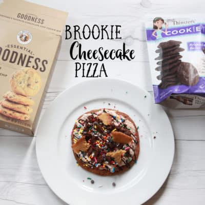"Brookie Cheesecake Pizza made with large Chocolate Chip Cookies and topped with ""cheesecake spread"" mixed with the Brownie Batter Cookie Thins"