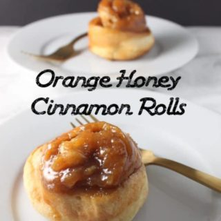 Orange zest, honey, butter, and brown sugar are what make these cinnamon rolls such a treat!