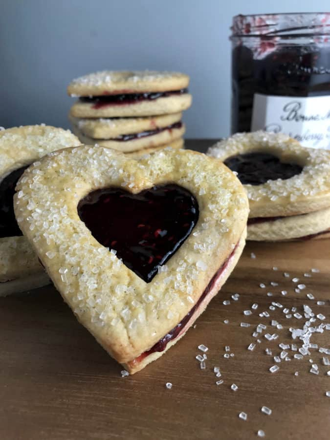 These Valentine Shortbread Cookies came out so cute and they are very easy to make with my shortbread dough, your favorite raspberry preserves, and sugar.