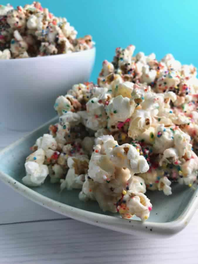 This Birthday Cake Popcorn is so addicting made with real ingredients! This popcorn has all the flavors of birthday cake but with no boxed processed mixes!!