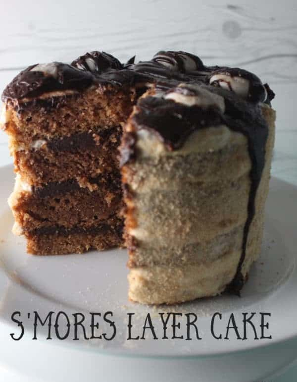 sThis S'mores Layer Cake is made with a graham cracker cake layered with chocolate ganache topped with homemade marshmallow fluff