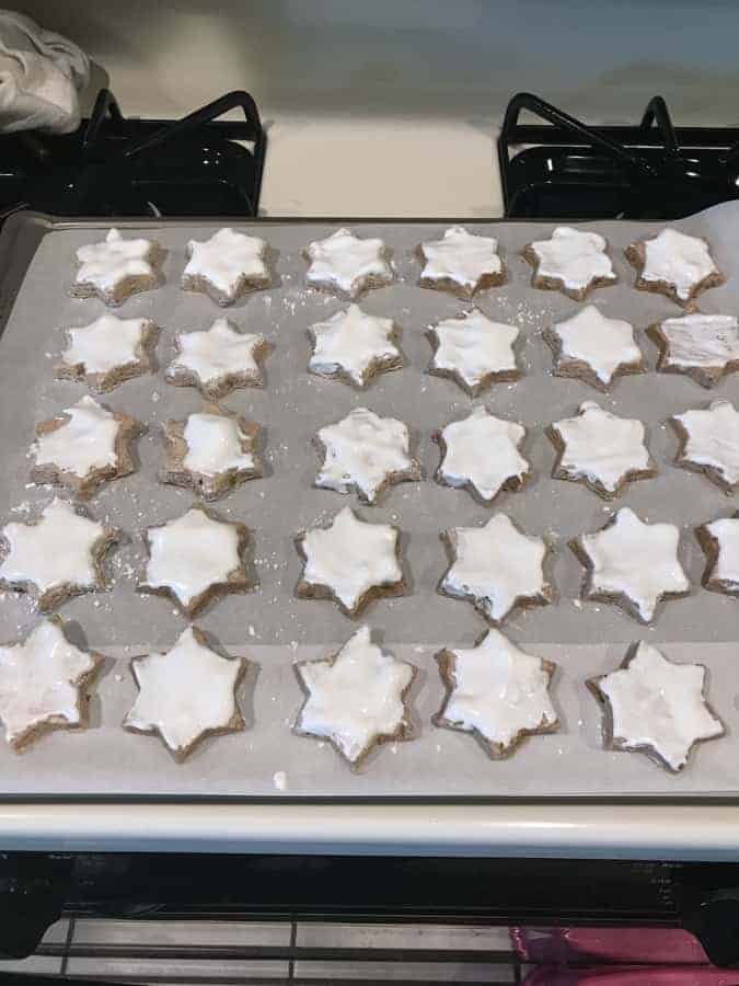 These Zimtsterne (German Cinnamon Stars) are chewy, nutty, sweet, and full of cinnamon flavor and so much fun to make!